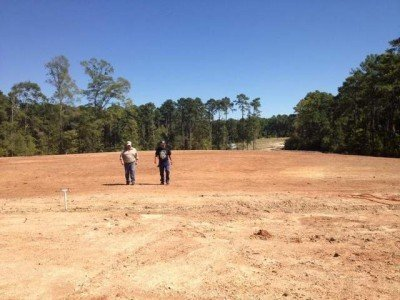Choctaw-Apache Tribe members Tom Procell (left) and Chief Johnny Procell walk the area that will serve as the center of the tribes new pow wow grounds.