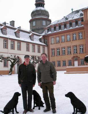 Prince Richard left and his son, Prince Gustav, stand in front of their palace in Bad Berleburg
