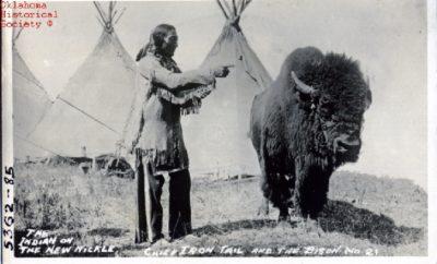 Chief Iron Tail and a buffalo